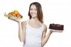 making hard choice between vegetables and chocolate cake
